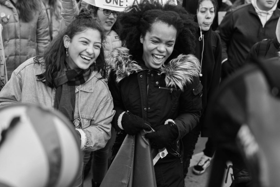 Student activists, Paulina Baker and Dija Manly break out in laughter at a student led climate strike.