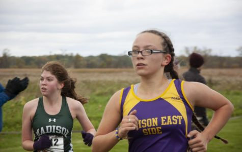 Freshman Bree Ward Debauche sprints to the finish line, determined to beat the girl next to her.