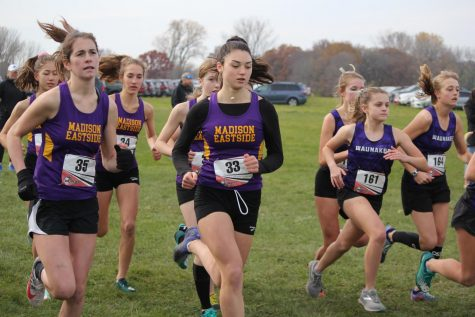 Runners sophomores Ava Ehrlinger and Rose Cooper, freshman Raena Keckhaver and juniors Sophia Reiner and Sabine Dolan-Gaschignard start the race off strong. The Girls Cross Country team competed in sectionals on Sat., Oct. 26 at Lake Farm County Park.