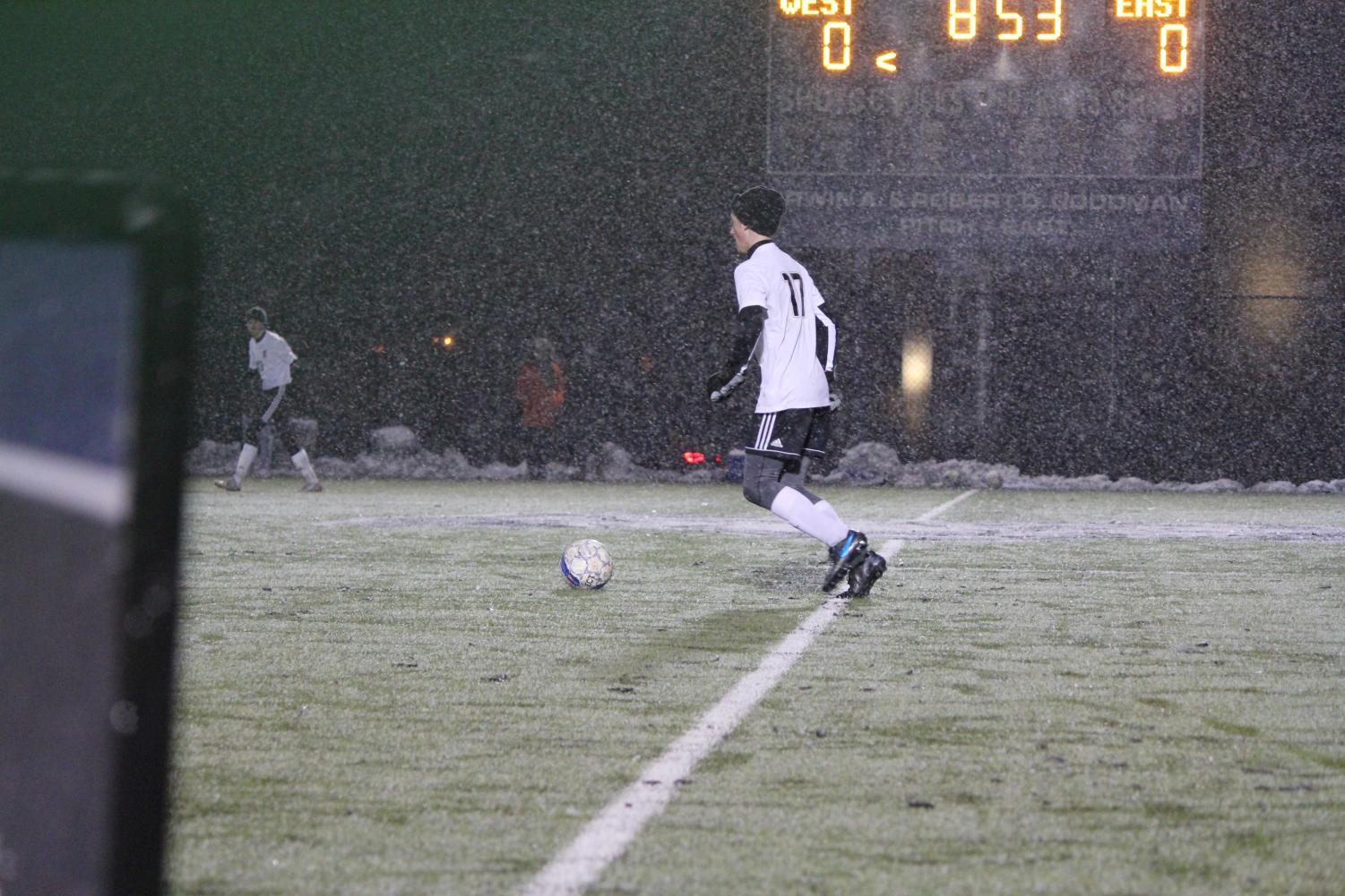 Senior Ben Bauman (#17) moments before he scores a goal against West in the semi-finals game on Nov.1.