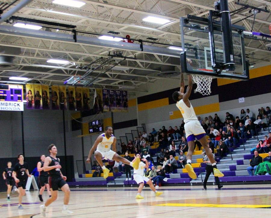 Senior+Keonte+Jones+dunks+the+ball%2C+impressing+the+crowd+as+teammate%2C+senior+David+McKinley+leaps+in+excitement+and+senior+Marcus+Justice+raises+the+roof.+%0A%0A%22Seeing+all+of+us+have+fun%2C+play+like+we+never+have+before+and+come+together+after+all+the+challenges+we+go+through%2C+it+was+an+amazing+experience%C2%A0and+game+overall%2C%22+Jones+said.